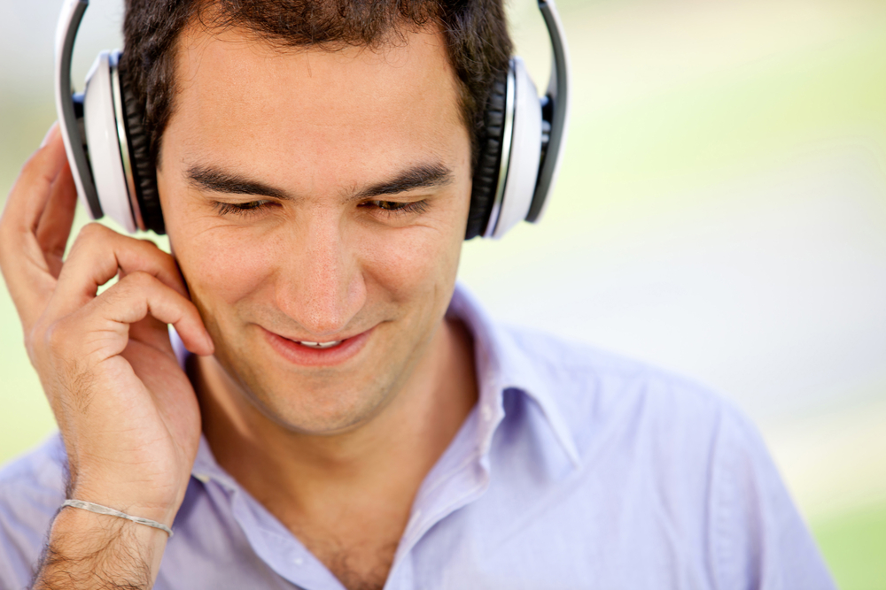 Man with headphones listening to music outdoors