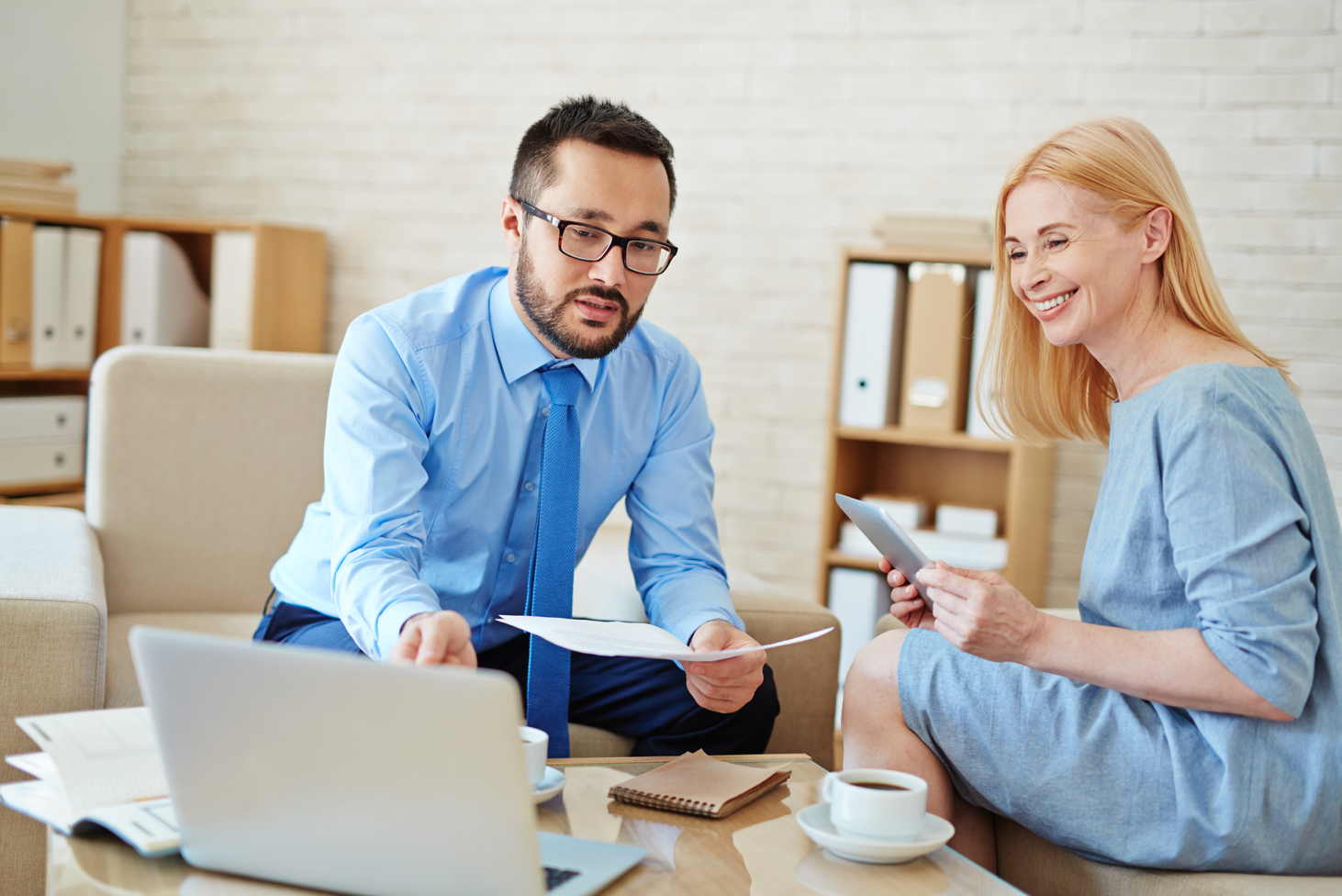 man woman computer meeting client tax accountant