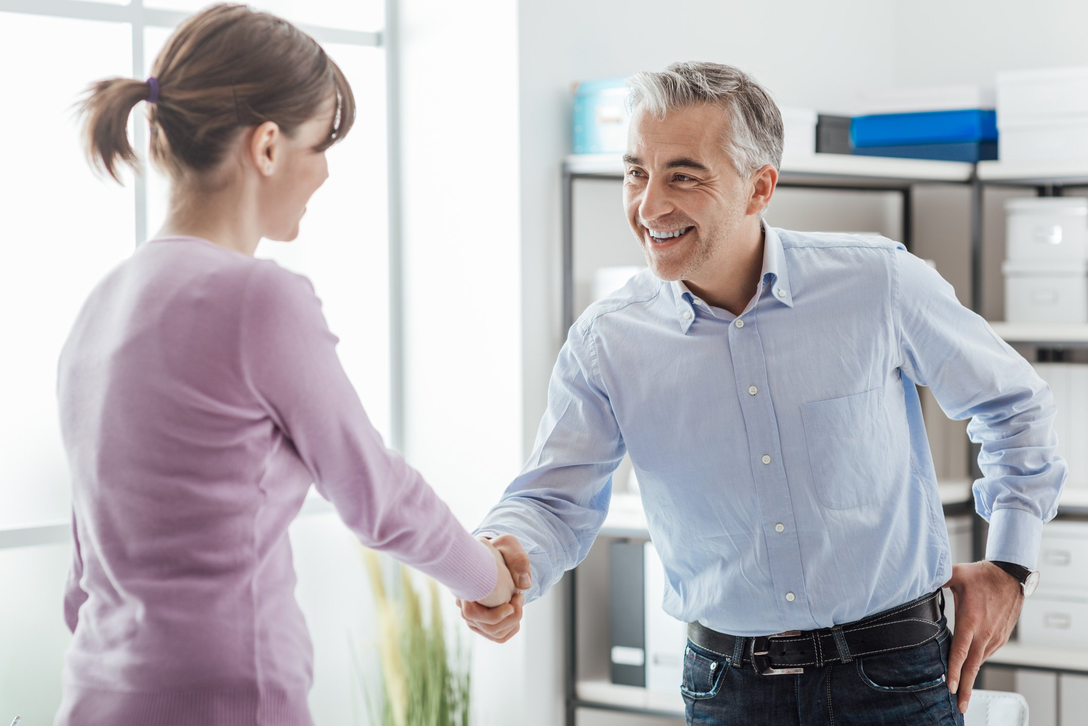 two accounting professionals shaking hands